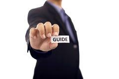 Homme jugeant de papier avec le texte de guide Photographie stock