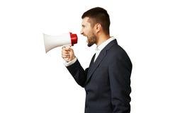 Homme à l'aide du mégaphone au-dessus du blanc Images stock