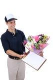 Homme livrant des fleurs Photo libre de droits