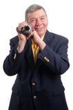 Homme mûr avec la caméra vidéo, d'isolement Images stock