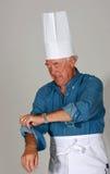 Homme mûr avec les chapeaux du chef Photos stock