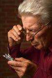 Homme mûr avec des pilules Image libre de droits