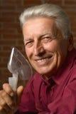 Homme mûr avec l'inhalateur Images libres de droits