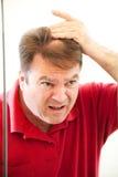 Homme mûr avec la correction chauve Photographie stock