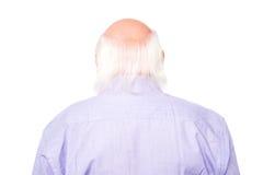 Homme mûr faisant face au mur Images stock