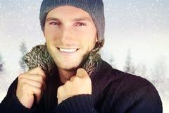 Homme mignon avec la neige Photographie stock