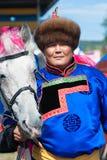 Homme mongol de Buryat avec le cheval Image stock