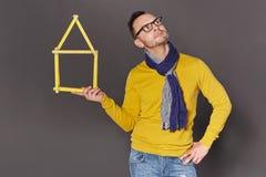 Homme montrant le concept de cadre de maison Photo libre de droits