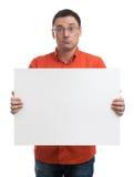 Homme montrant le signe blanc vide de panneau d'affichage Photographie stock libre de droits