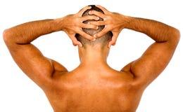 Homme musculaire affichant le sien arrière Photographie stock libre de droits