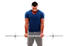 Homme musculaire faisant des exercices avec le barbell Photos stock