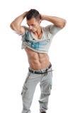 Homme musculaire puissant posant sur un fond blanc photographie stock