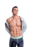 Homme musculaire puissant posant sur un fond blanc photo libre de droits