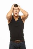 Homme musculeux bel étonné Image stock