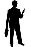 Homme noir de silhouette sur le blanc image stock