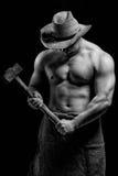 Homme nu avec un marteau Photos stock