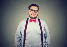 Homme obèse satisfait dans l'habillement formel Photos stock