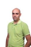 Homme occasionnel avec la chemise de polo verte image stock