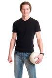 Homme occasionnel avec le volleyball Photographie stock libre de droits