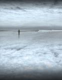 Homme paisible sur la plage Image libre de droits