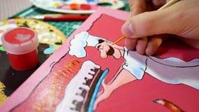 Homme peignant le tableau drôle d'art Photographie stock libre de droits