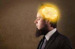 homme pensant avec l'illustration rougeoyante de cerveau Images stock
