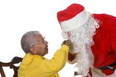 Homme plaisant dans le procès de Santa Image stock