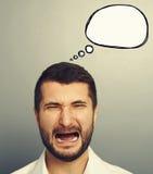 Homme pleurant avec le ballon vide de la parole Photos libres de droits