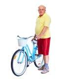 Homme plus âgé avec la bicyclette Photographie stock