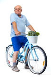 Homme plus âgé avec la bicyclette et les légumes Photographie stock libre de droits