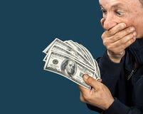 Homme plus âgé avec le ventilateur des dollars Photo stock