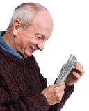 Homme plus âgé heureux avec des dollars Image libre de droits