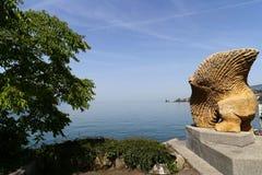 Homme Poisson Volant rzeźba Gaspard Delachaux przy Quai De Los angeles Rouvenaz na bankach Jeziorny Genewa, szwajcar Riviera, Mon Zdjęcie Royalty Free