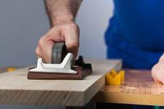 Planche en bois de polissage Photographie stock libre de droits