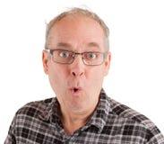 Homme posant sérieusement des questions Photos libres de droits