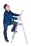 Homme prêt à monter une échelle Images libres de droits