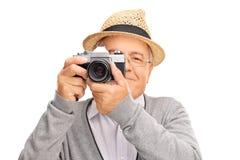 Homme prenant une photo avec un appareil-photo Images stock