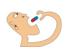 Homme prenant une pilule Photos stock