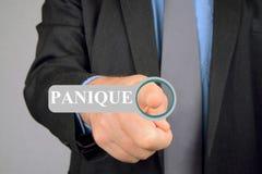 Homme pressant la panique de mot en français photos stock