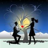 Homme proposant le mariage au femme Photo stock