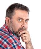 Homme réfléchi de Moyen Âge avec la main près du visage Image libre de droits