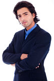 Homme réussi bel d'affaires dans la moitié de procès prêtée photographie stock