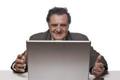 Homme réussi heureux d'affaires avec un ordinateur portatif Images libres de droits
