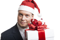 Homme retenant un cadre de cadeau Image libre de droits