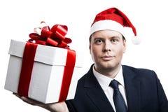 Homme retenant un cadre de cadeau Photo stock