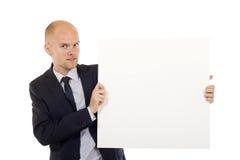 Homme retenant un panneau blanc Photo stock