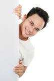 Homme retenant un panneau-réclame blanc. Photos libres de droits