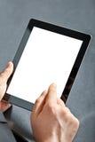Homme retenant un touchpad Photographie stock