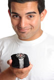 Homme retenant une montre-bracelet de chronographe images libres de droits