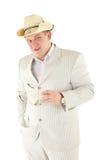 Homme sérieux dans un costume blanc Images stock